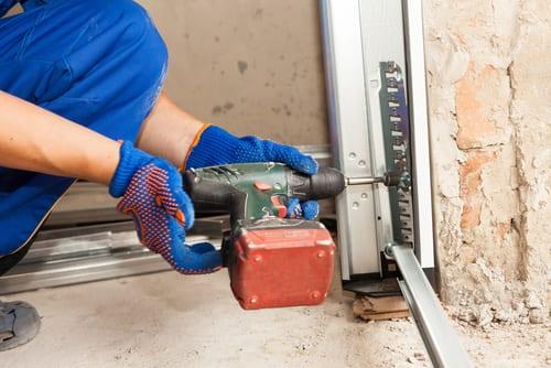 image of repairman working on the garage door